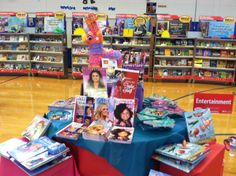 Book Fair Fiesta table display.  Layer with wrapped boxes and top off with a pinata!