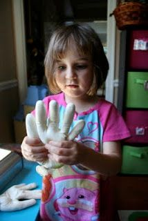 "Popsicle sticks inside rubber gloves for ""bones"""