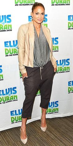Last Night's Look: Love It or Leave It? | JENNIFER LOPEZ | Just because she's doing radio doesn't mean J.Lo isn't going to put thought into her outfit. The Idol judge rocks cropped pants, a draped top and a leather jacket when she visits Z100 in N.Y.C.
