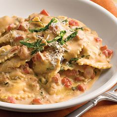 Tuscan Pasta With Tomato-Basil Cream - 33 One-Dish Dinners | Southern Living - This elegant pasta dinner will have your family thinking you worked in the kitchen all day long. The secret, though, is refrigerated ravioli and jarred Alfredo sauce that's heated with white wine, chopped fresh tomatoes, and fresh basil. Top with grated Parmesan cheese for a tasty finishing touch.