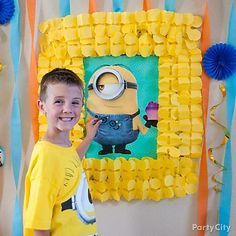 """Pin the pocket on Stuart! Decorate the party game with yellow garland, streamers and blue fans for a """"minion"""" times more fun!"""
