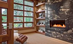 This rectangular fireplace is embedded in a completely solid marble mantle. How luxurious! Medina, WA Coldwell Banker BAIN $4,588,000