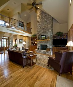 Great room of the Rockledge, plan 875 www.dongardner.com - The kitchen partitions the dining room and breakfast area and easily accesses a screened porch for outdoor entertaining. The great room features a two-story fireplace and French doors that lead to the rear porch. A family room also sports a fireplace and patio access. #Vaulted #GreatRoom #LivingRoom