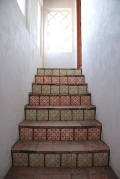 Beautiful Spanish tile will brighten up any western staircase. Perfect for southwestern homes. | Stylish Western Home Decorating