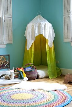 Beautiful Reading Canopy by sewliberated: Made by sewing silk onto a circular hand quilting hoop which was suspended with hemp twine to a sling ring and then hung from a ceiling hook with fishing wire. Another square of white silk was draped over the top. #Reading_Canopy #Play_Tent