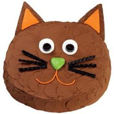 cat cake; round cake; cat face; easy birthday cake for kids (try pink frosting, eyelashes, red twizzlers for wiskers)