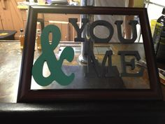 Picture frame with painted wooden letters