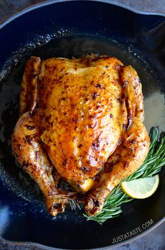 Simple Roast Chicken with Garlic and Lemon in iron skillet