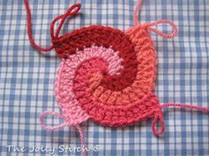 Spiral Crocheted Stitch! Would be cool to do a big one (3-4ft diameter) in colors to match the couches as a throw to cuddle with and watch tv.