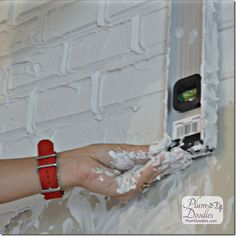 CLEVER! Create faux bricks with drywall mud and level | PlumDoodles.com