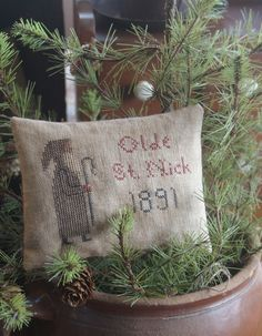 Olde Saint Nick Stitchery Pillow...stitched by Olde Threads, design Early America 1815...pine in a crock.