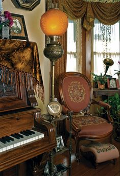 A gold velvet shawl embroidered with flowers drapes over the piano.