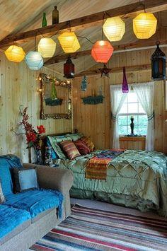 bohemian bedroom with great lighting.