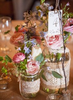They put full-bloom garden flowers in the jars of this rustic wedding centerpiece.    photo taken by Paul & Jewel Studios