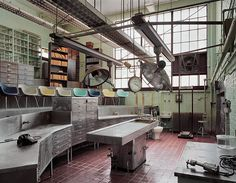 Autopsy Theater, St. Elizabeth's Hospital, Washington, DC.     I don't know how much the artist arranged this room for his photo...but wow. The muted rainbow of chairs...the orange books, the phone all by itself....and the sweet creepiness of being an abandoned autopsy theater.