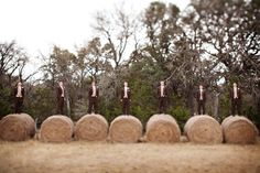 Great shot of groom and groomsmen on haybales
