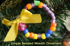 Easy Christmas craft for kids to make - Beaded wreath ornament (happy hooligans)