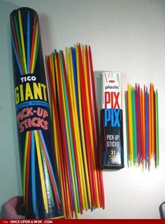 This is a huge classic game from the past! I guess every kid had one! I had one in my time, back in the 70s........  It was a fun game, where you would throw the sticks on the floor or table and then players would take turns in removing one stick at a time without moving the other sticks! If you failed you would loose! The winner was the last player standing! Fun, fun, fun!!!