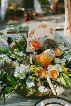 lush centerpiece with tropical flowers, photo by Amber Vickery Photography http://ruffledblog.com/late-summer-bohemian-inspiration #weddingflowers #centerpieces