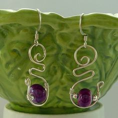A design of mine. Relegated to page 54 of a Google search for images of Lampwork and Wire jewelry. Alas.