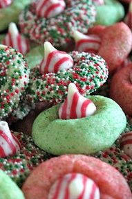 Roll sugar cookie dough in sprinkles or colored sugar before baking. When mostly cooled, smash kisses on top.