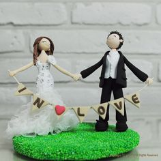Cute couple holding banner wedding cake topper gift  by annacrafts, $180.00