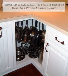 hang-your-pots-and-pans-in-the-kitchen Like this soooo much better than stacking them
