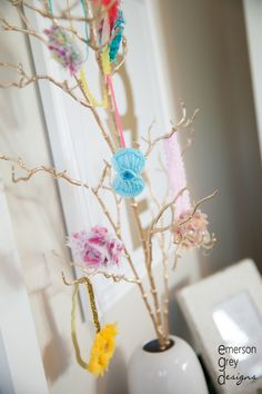 Love the use of gold spray-painted branch to hold headbands in the nursery!