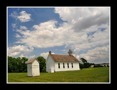 This restored one room school house is on the grounds of the Kansas State Historical Society Museum in Topeka, KS.