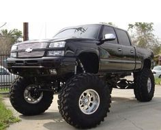 CHEVY GIRL LOVE THE BIG BLACK JACKED UP TRUCK