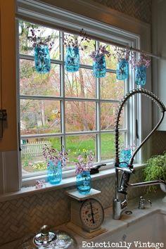 blue mason jars, masons, mason jar crafts, jar window, kitchen windows