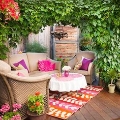 Love the colors of this small deck! Create a relaxing retreat on your outdoor deck with pillow-padded furniture and colorful accessories! Frame the space with an arching flowering vine.