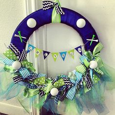 Baby Wreath by CraftsOnAMission on Etsy, $35.00-not a big fan of the golf theme but cute for a baby boy shower wreath! golf baby shower, babi wreath, baby boy shower golf, baby shower golf, baby wreath boy, baby boy golf shower, boy baby wreath, baby wreaths, babi shower
