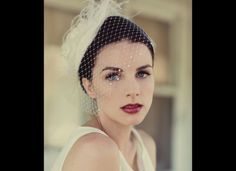 Stunning lace fascinator and veil.