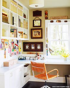 This multipurpose office is designed for dozens of projects. Built-in overhead open shelving and long countertops, along with orderly cabinets and bins, provide a perfect setting for paying bills, mending clothes, completing crafts projects, organizing photographs, and writing letters.