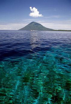 A volcano near Bunaken Island in North Sulawesi, Indonesia, with the coral reef visible under the water. Sulawesi (Indonesia) - Manado Tua by ๑۩๑ V ๑۩๑, via Flickr