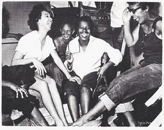 "I've always loved this photo of Dorothy Dandridge relaxing with extras on the set of ""Carmen Jones"". What do you think they were talking about? Photo: Schomburg Center for Research in Black Culture, New York Public Library."