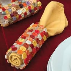 Popsicle/craft sticks,toilet tubes covered in button patterns to decorate the thanksgiving table