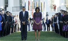 First Lady Michelle Obama wears Peter Som coat during a moment of silence to commemorate September 11th.