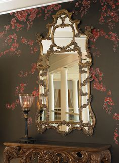 Hand carved Baroque mirror by La Barge  Hand carved overscaled Baroque mirror in antique gold with red umber highlights.  Item: LM1791   Dimensions: 49.0W x 2.0D x 87.0H inches
