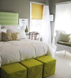 dark gray walls + green accents in the bedroom