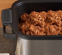 We make this pulled pork in the slow cooker at least once a month then  use it on pizza, salads, sandwiches and with beans on rice!  YUMMO