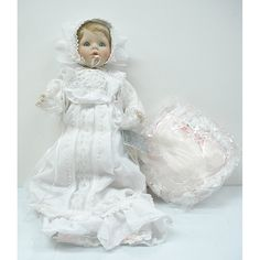 "Susan Wakeen & The Danbury Mint Porcelain ""Christening Day"" Doll, Blonde hair/Blue eyes, She is laying down and comes with a pink heart shaped satin pillow. I own three of this doll. I am selling two and keeping one, I am asking $75.00 OBO"