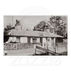 """Captioned: """"Canal #lock #cottage cowley print. A reproduction from a good quality photo postcard of Cowley lock, on the Grand Union canal in #Middlesex UK in the early 20th century possibly around 1920. The lock #keeper and his wife are standing by the gate of the cottage with a terrier sitting on the wall next to them. the top of the lock gates are in the foreground. The date of 1893 is legible on the lock wall"""". #cowley #canal #grand #union #barge #narrowboat #toll #wideboat #london"""