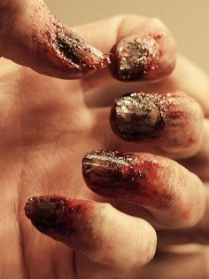 For a less subtle look: crusty zombie nails.   27 Disgustingly Awesome Ways To Take Halloween To The Next Level