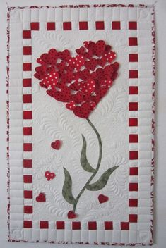 Heart Wall Hanging at Sew Grateful Quilts. The hearts are only stitched down the middle.