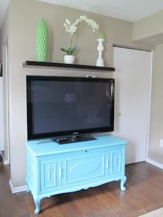 Painted Hope Chest.  TV Stand.  Paint Color Eddie Bauer Sea Breeze - pretty close the the wall/tv stand color scheme I was looking for
