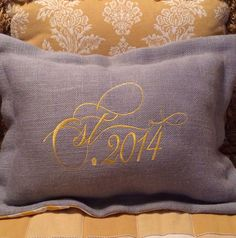 Est 2014 makes a beautiful wedding or anniversary gift.. Custom designed & monogrammed for your special couple in their own colors... This one is Gray burlap with yellow stitching and a yellow chevron fabric on the back....$68.00 cindyjaegerdesigns@hotmail.com