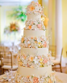 4-tiered white wedding cake with spring-inspired sugar flowers | Jessica Strickland | Theknot.com