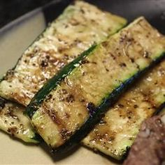 Balsamic Grilled Zucchini   1.Preheat grill for medium-low heat and lightly oil the grate.  2.Brush zucchini with olive oil. Sprinkle garlic powder, Italian seasoning, and salt over zucchini.  3.Cook on preheated grill until beginning to brown, 3-4 minutes per side. Brush balsamic vinegar over the zucchini and continue cooking 1 minute more. Serve immediately.